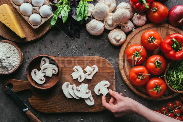 Coup femme ingrédients pizza concrètes table Photo stock © LightFieldStudios
