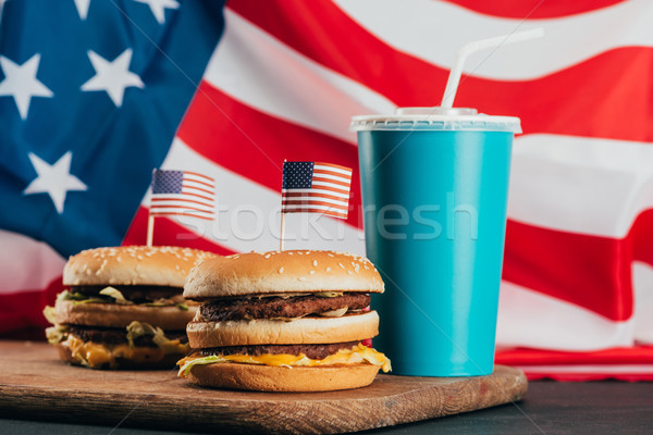 close up view of burgers with american flags and soda drink, presidents day celebration concept Stock photo © LightFieldStudios