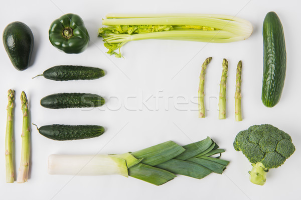 Flat lay composition of green vegetables isolated on white background Stock photo © LightFieldStudios