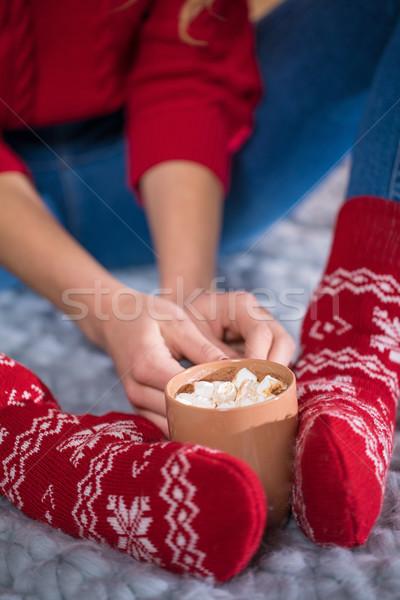 Női láb csésze forró csokoládé közelkép kilátás Stock fotó © LightFieldStudios