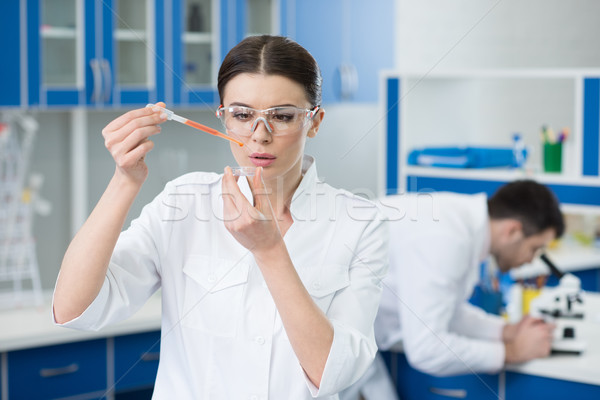 portrait of concentrated woman scientist working in lab Stock photo © LightFieldStudios