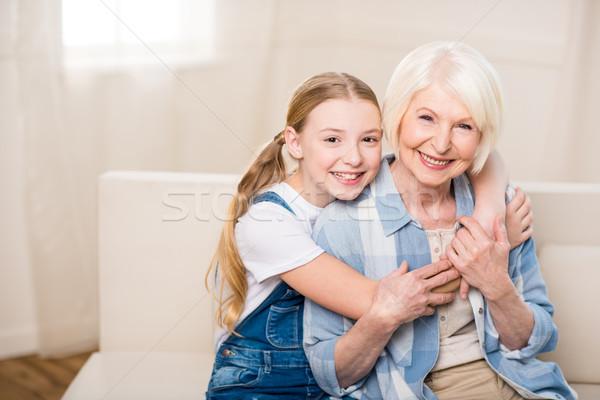 Szczęśliwy babcia wnuczka uśmiechnięty kamery Zdjęcia stock © LightFieldStudios