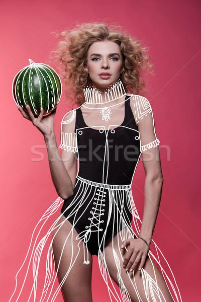 woman holding fresh watermelon Stock photo © LightFieldStudios