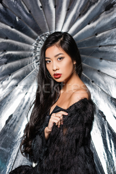 woman wearing ostrich feathers Stock photo © LightFieldStudios