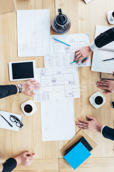 businessmen working with blueprints Stock photo © LightFieldStudios