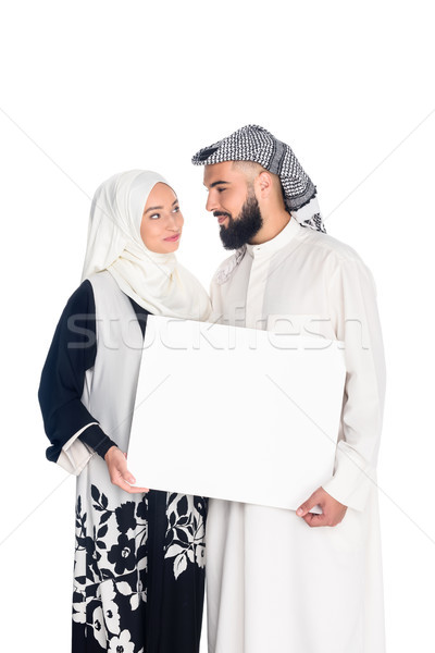 Stock photo: muslim couple holding blank board