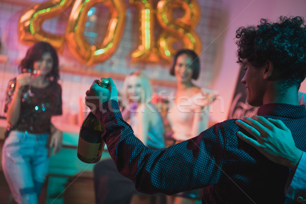 Homme champagne vue arrière bouteille Photo stock © LightFieldStudios