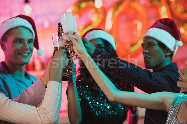 multiethnic friends clinking glasses of champagne Stock photo © LightFieldStudios