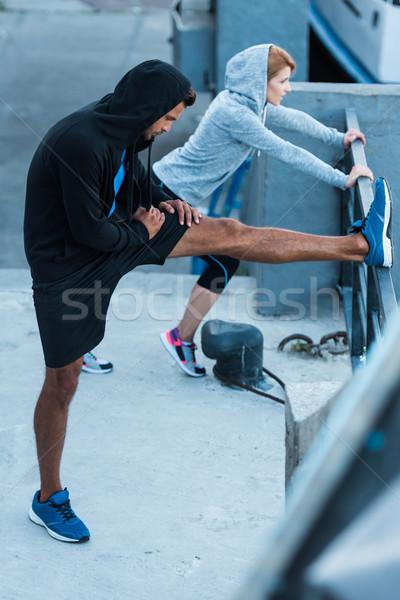 sportswoman and sportsman stretching in city  Stock photo © LightFieldStudios