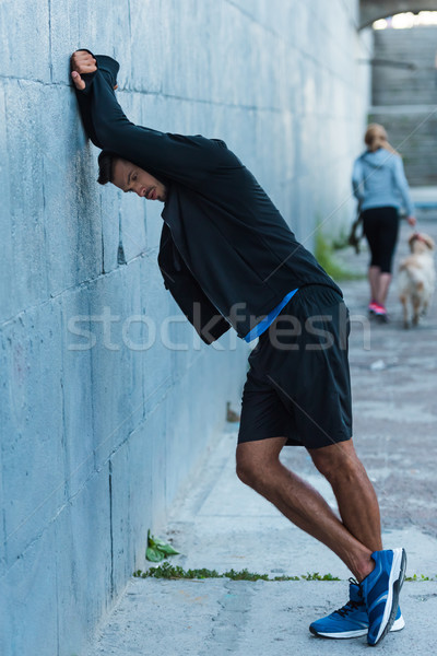 sportsman standing at wall Stock photo © LightFieldStudios