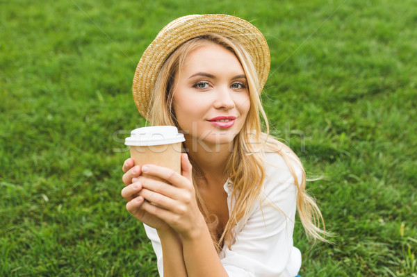 woman with coffee to go Stock photo © LightFieldStudios