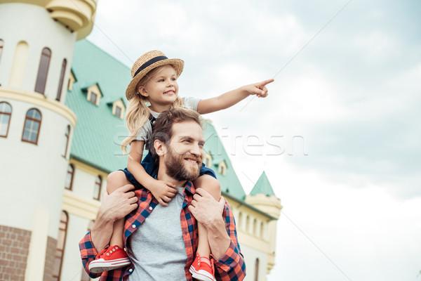 father and daughter piggybacking together Stock photo © LightFieldStudios