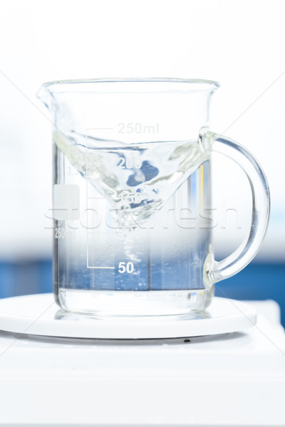 close up view of chemical liquid in laboratory glassware on scales Stock photo © LightFieldStudios