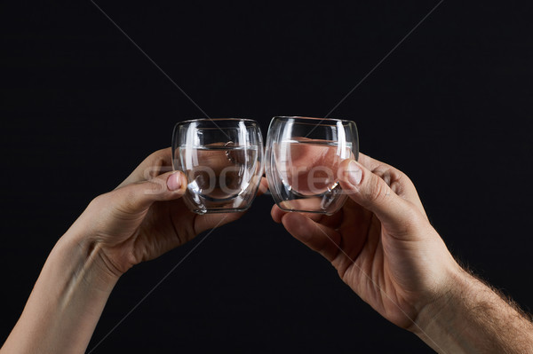 cropped shot of man and woman clinking glassed isolated on black Stock photo © LightFieldStudios