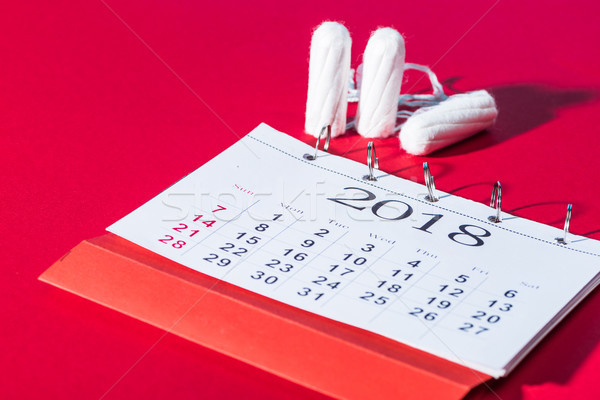 cotton feminine tampons and calendar on red Stock photo © LightFieldStudios