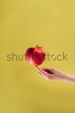 partial view of woman holding apple on finger Stock photo © LightFieldStudios