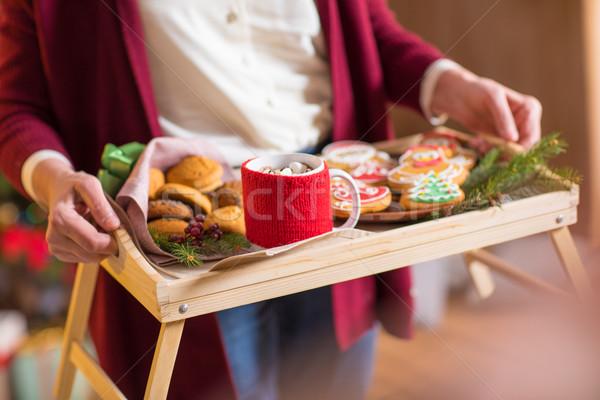 Woman holding tray with christmas cookies Stock photo © LightFieldStudios