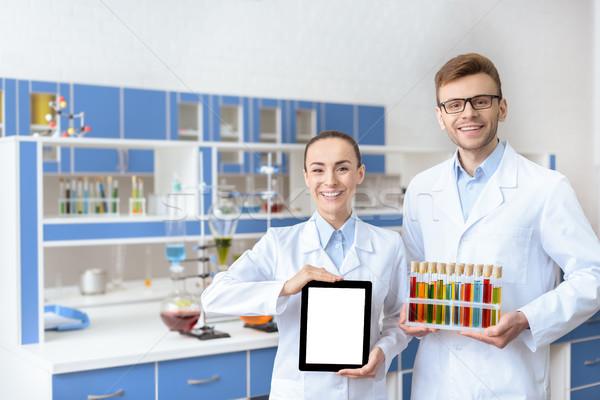 молодые улыбаясь лаборатория цифровой таблетка Сток-фото © LightFieldStudios