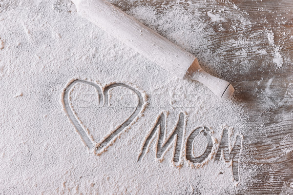 'Top view of heart symbol and word mom in flour on wooden table, Mothers day concept Stock photo © LightFieldStudios