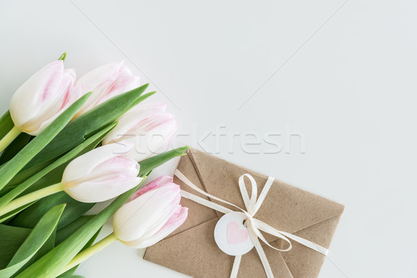 light pink tulips and envelope isolated on white with copy space, wedding cards flowers concept Stock photo © LightFieldStudios