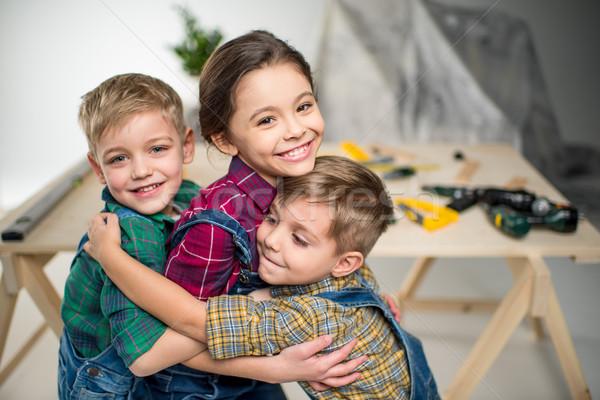 Stock photo: Happy kids hugging