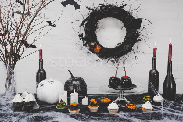 halloween cupcakes and decorations Stock photo © LightFieldStudios