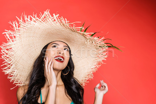 Stock photo: Smiling woman in swimsuit and beach hat