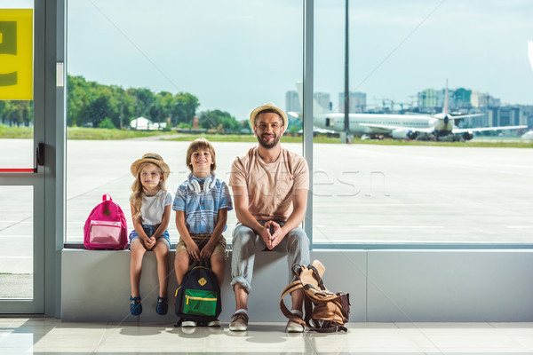 Stock photo: father and kids waiting for boarding