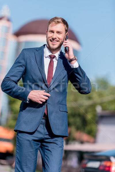 Stock photo: businessman in suit using smartphone