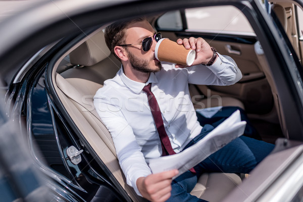 businessman drinking coffee in car Stock photo © LightFieldStudios