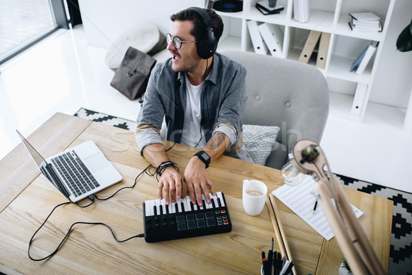 young sound producer Stock photo © LightFieldStudios