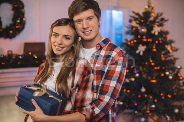 Férfi ölel barátnő karácsony ajándék portré Stock fotó © LightFieldStudios