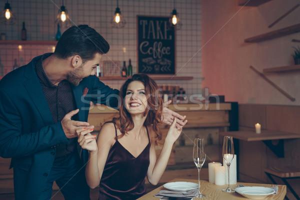 Man verrassend vrouw jonge man opgewonden tabel Stockfoto © LightFieldStudios