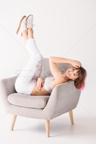 Сток-фото: женщину · ног · воздуха · молодые · улыбающаяся · женщина · розовый