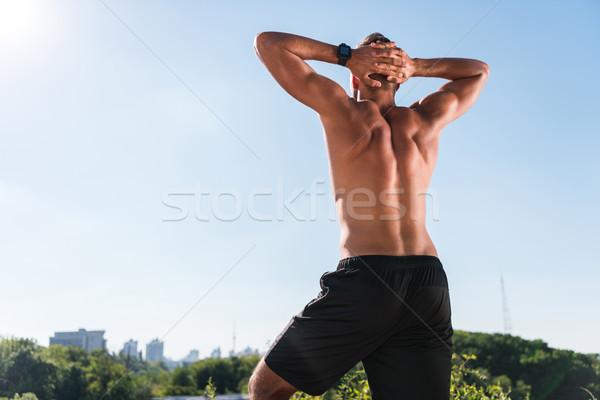 筋肉の シャツを着ていない スポーツマン 背面図 青空 フォアグラウンド ストックフォト © LightFieldStudios