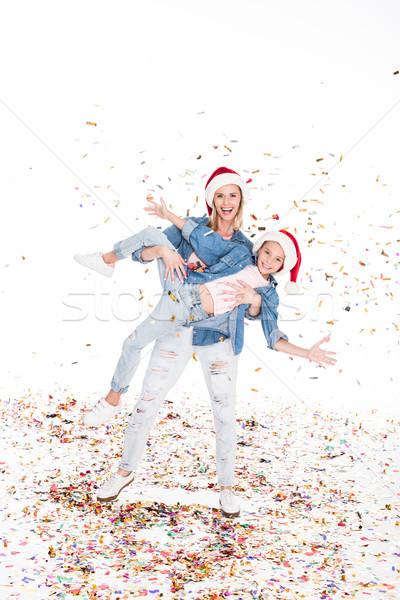 Famille confettis Noël mère fille Photo stock © LightFieldStudios