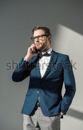 businessman rupture paper with hand Stock photo © LightFieldStudios