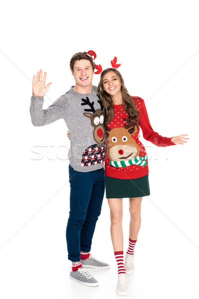 smiling couple in winter sweaters Stock photo © LightFieldStudios