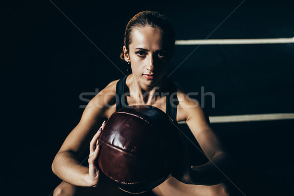 sportswoman with weighted ball Stock photo © LightFieldStudios