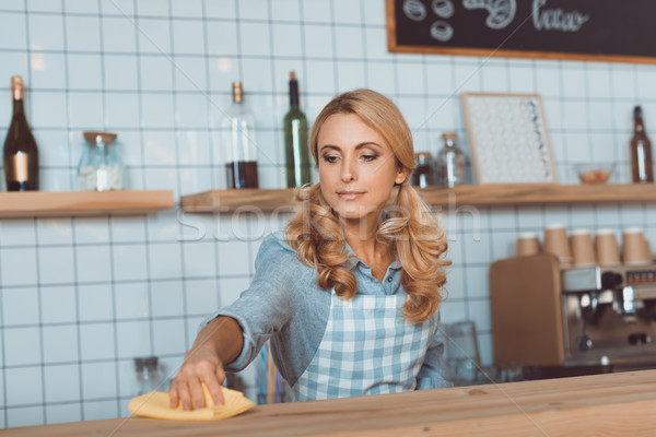 waitress cleaning bar counter Stock photo © LightFieldStudios