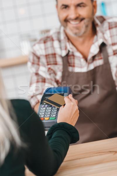 woman paying with pos terminal at cafe Stock photo © LightFieldStudios