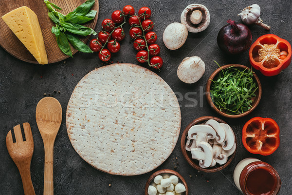 top view of pizza dough with various vegetables for topping on concrete table Stock photo © LightFieldStudios