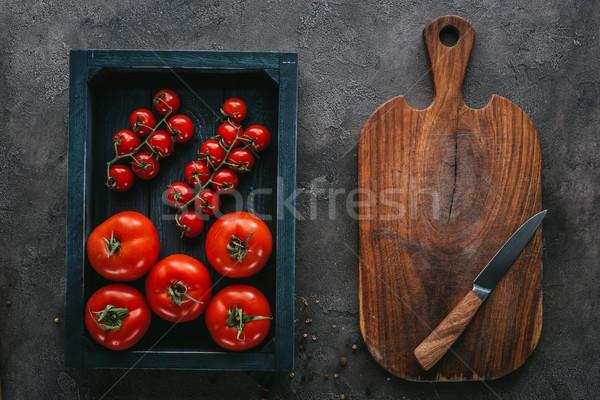 Superior vista tomates cuadro concretas superficie Foto stock © LightFieldStudios