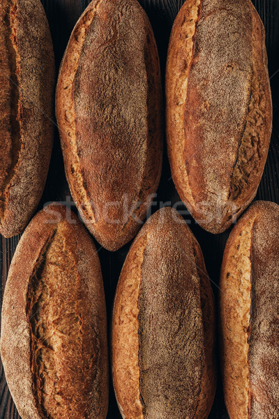 Stock photo: top view of freshly baked arranged loafs of bread