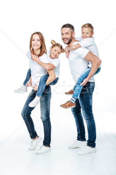 Parents piggybacking happy children Stock photo © LightFieldStudios