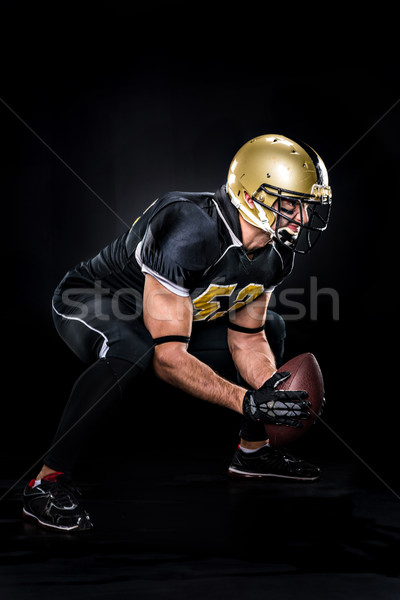 American football player crouching Stock photo © LightFieldStudios