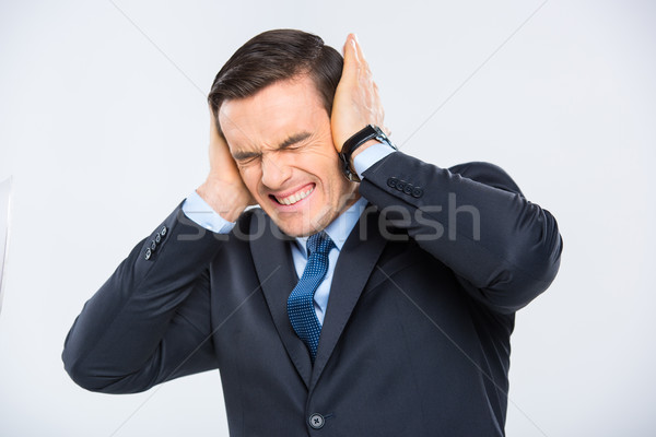 Businessman closing his ears Stock photo © LightFieldStudios