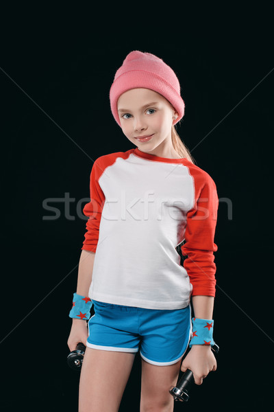 girl training with dumbbells isolated on black. athletics children concept Stock photo © LightFieldStudios