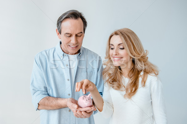 Foto stock: Sorridente · casal · moeda · pequeno · piggy · bank