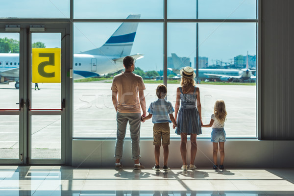 family looking out window in airport Stock photo © LightFieldStudios